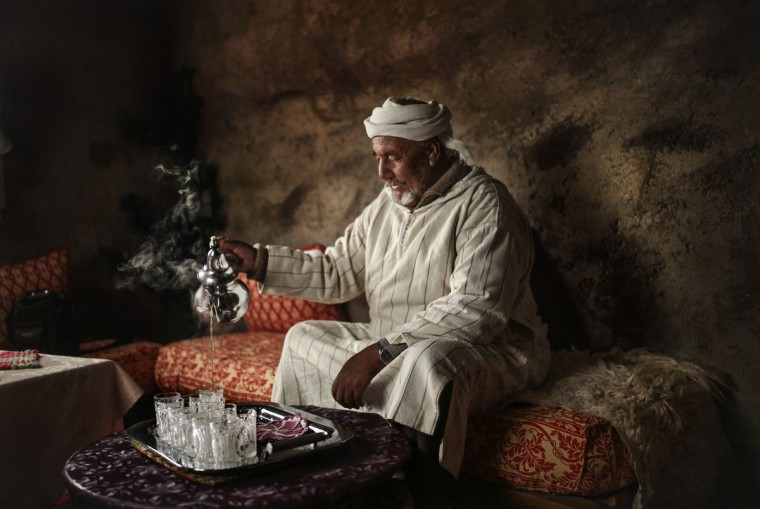 Hajj Saeed, 56, an Amazigh villager, pours tea for guests at his home in the Middle Atlas town of Tounfit, near the province of Midelt, central Morocco. Across North Africa, the Berbers number about 50 million. At least 15 million Moroccans are Amazigh, divided into different groups according to their dialects. While they speak the native Amazigh language of Tamazight, which has a large number of dialects and recently gained recognition as an official language in Morocco, many have adopted Arabic as part of a long process of Arabization and Islamization. (AP Photo/Mosa'ab Elshamy)
