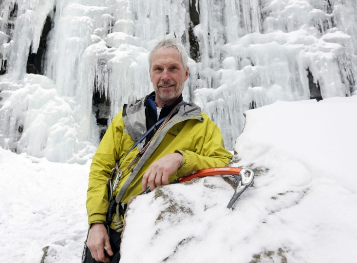 In this Wednesday, Feb. 10, 2016 photo, ice climber Don Mellor poses at Pitchoff Quarry in Keene, N.Y. Mellor began ice climbing in the make-your-own tools era and has since introduced the sport to generations of students at a Lake Placid prep school where he is a teacher and counselor. He wrote the book, literally, on ice climbing in this rugged region. (AP Photo/Mike Groll)