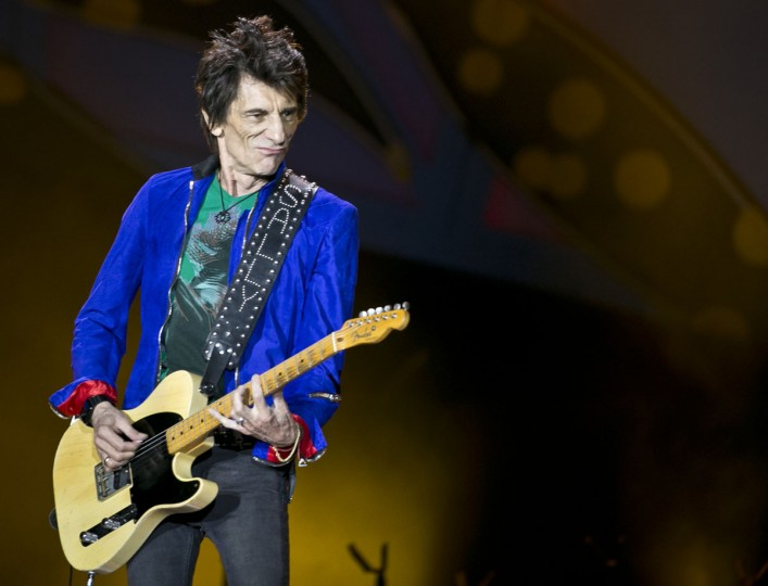Guitarist Ron Wood performs during a Rolling Stones concert in Havana, Cuba, Friday March 25, 2016. The Rolling Stones unleashed two hours of rock and roll on an crowd of hundreds of thousands of Cubans and foreign visitors Friday March 25, 2016, capping one of the most momentous weeks in modern Cuban history with a massive celebration of music that was once forbidden here. (AP Photo/Enric Marti)