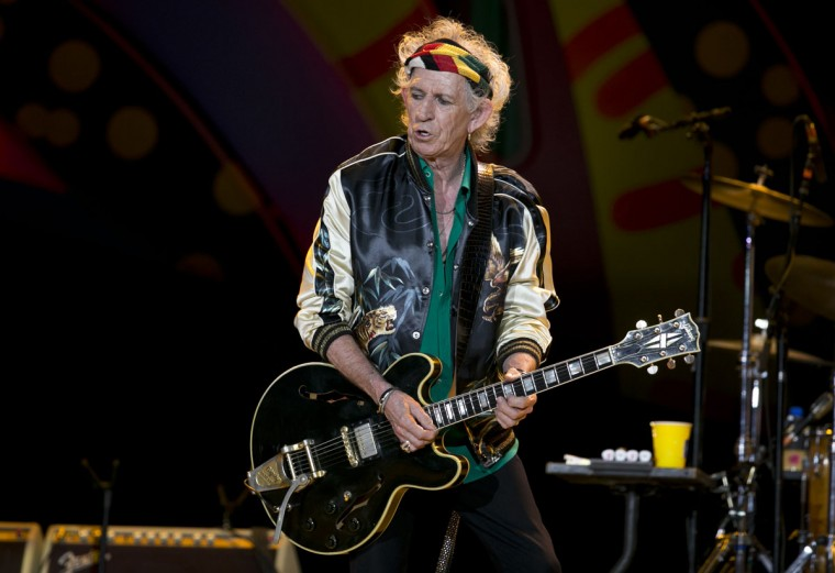 Guitarist Keith Richards performs during a Rolling Stones concert in Havana, Cuba, Friday March 25, 2016. The Rolling Stones unleashed two hours of rock and roll on an crowd of hundreds of thousands of Cubans and foreign visitors Friday March 25, 2016, capping one of the most momentous weeks in modern Cuban history with a massive celebration of music that was once forbidden here. (AP Photo/Enric Marti)