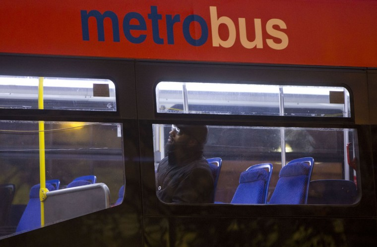 A man sits alone inside a Metrobus in downtown Washington, Wednesday, March 16, 2016. The Metro subway system that serves the nation's capital and its Virginia and Maryland suburbs shut down for a full-day for an emergency safety inspection of its third-rail power cables. Making for unusual commute, as the lack of service is forcing some people on the roads, while others are staying home or teleworking. (AP Photo/Pablo Martinez Monsivais)