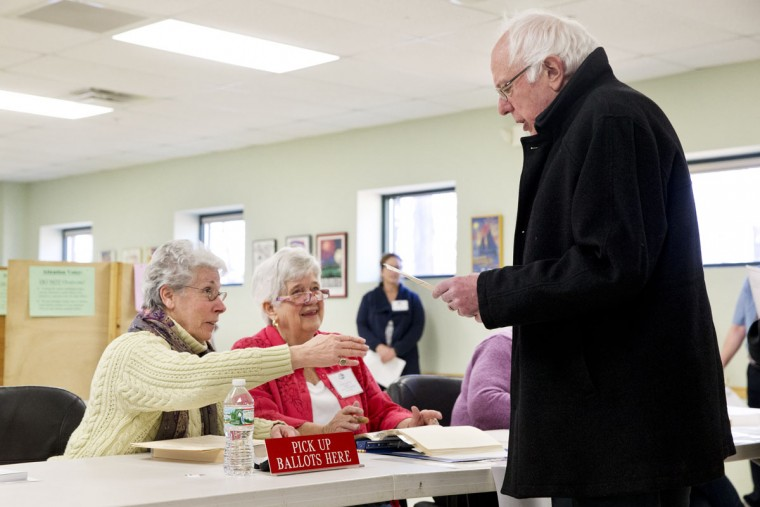 Democratic presidential candidate Sen. Bernie Sanders, I-Vt., takes a ballot to vote in the Vermont primary at the Robert Miller Community and Recreation Center in Burlington, Vermont, Tuesday, March 1, 2016, on Super Tuesday. (AP Photo/Jacquelyn Martin)
