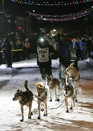 Dallas Seavey approaches the finish of the Iditarod Trail Sled Dog Race, Tuesday, March 15, 2016, in Nome, Alaska. Seavey won his third straight Iditarod, for his fourth overall title in the last five years. (AP Photo/Mark Thiessen)