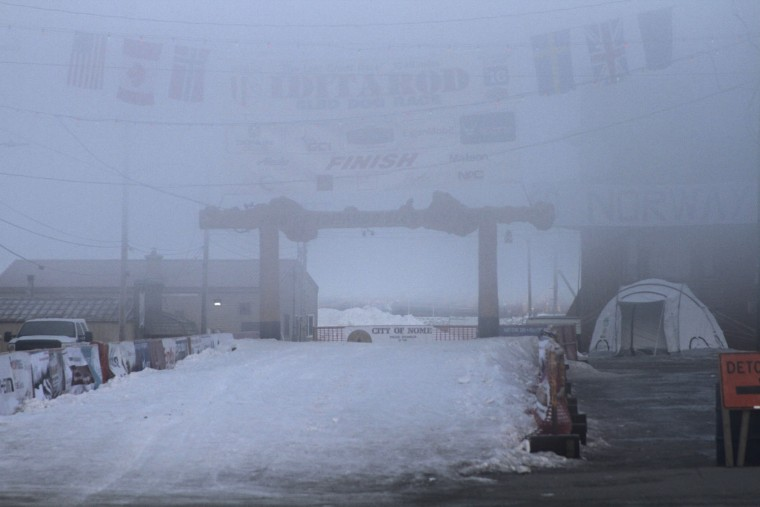 Fog obscures the burled arch over the finish line of the Iditarod Trail Sled Dog Race in Nome, Alaska, on Thursday, March 17, 2017. Eighty-five mushers began the nearly 1,000-mile race to Nome from Anchorage on March 6. As of Thursday morning, 43 mushers had reached Nome, 13 have scratched and 29 remain on the trail. (AP Photo/Mark Thiessen)