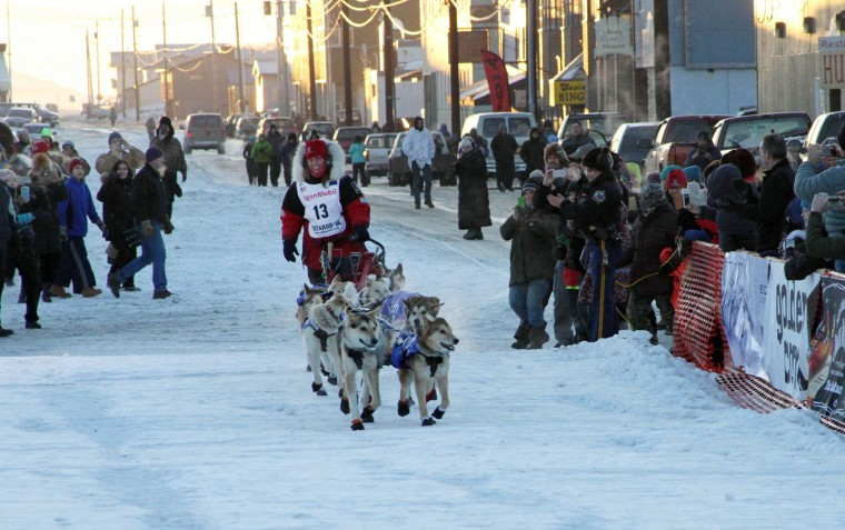 Musher Aliy Zirkle drives her dog team to the finish line of the Iditarod Trail Sled Dog Race, Tuesday, March 15 2016, in Nome, Alaska. Zirkle finished third in the race. (AP Photo/Mark Thiessen)