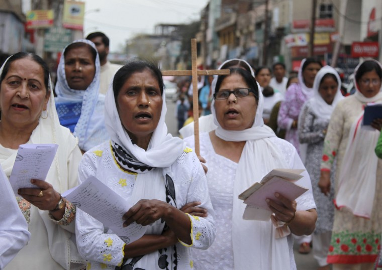 Indian Christians pray during a procession to mark Good Friday in Jammu, India, Friday, March 25, 2016. Christians all over the world are marking the solemn period of Easter. (AP Photo/Channi Anand)