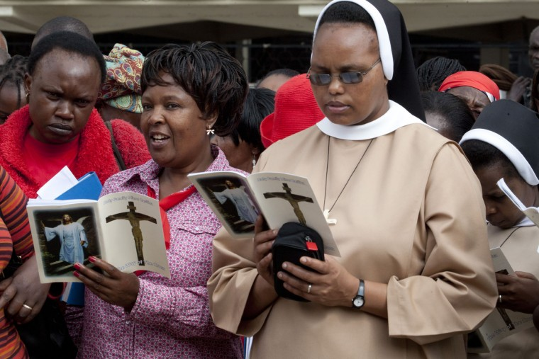 A Christian faithful prays near the Holy Family Basilica, Nairobi, Kenya, Friday, March 25, 2016, on Good Friday during the Holy Week of Easter. Christians around the world are marking the death of Jesus Christ ahead of Easter Sunday. (AP Photo/Sayyid Abdul Azim)