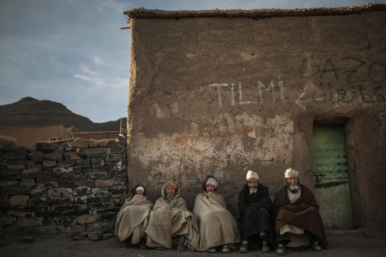 Amazigh villagers rest as the sun sets in a village near Midelt, a town in central Morocco between the Middle and High Atlas mountains. Across North Africa, the Berbers number about 50 million. At least 15 million Moroccans are Amazigh, divided into different groups according to their dialects. While they speak the native Amazigh language of Tamazight, which has a large number of dialects and recently gained recognition as an official language in Morocco, many have adopted Arabic as part of a long process of Arabization and Islamization. (AP Photo/Mosa'ab Elshamy)