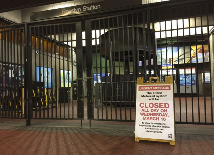 A sign at the Rosslyn, Va., Metro station notifies riders that the system is closed for emergency inspection Wednesday, March 16, 2016. An unprecedented safety shutdown of the Metro subway system inconvenienced hundreds of thousands of people in and around the nation's capital on Wednesday. Federal workers telecommuted or took the day off, children missed school and countless others woke up early to take bus after bus, hail pricey taxis or slog through traffic. (AP Photo/Jessica Gresko)