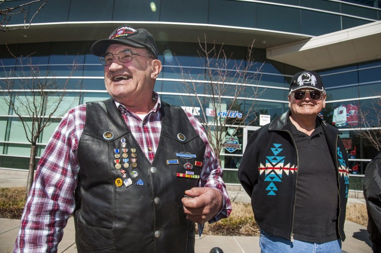 Larry Welch, U.S. Army 82nd Airborne Division, shows off his combat medals during a ceremony at the Spokane Veterans Memorial Arena to honor Vietnam Veterans, Tuesday, March 29, 2016, in Spokane, Wash. The day marks the anniversary of the last day on which U. S. troops were on the ground in Vietnam. (Dan Pelle/The Spokesman-Review via AP)