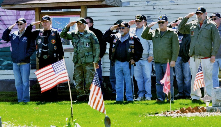 Vietnam War veterans salute during a ceremony commemorating the 50th anniversary of the Vietnam War at the Ashtabula war memorial in Ashtabula, Ohio, Tuesday, March 29, 2016. From left, front row, are William Butterfield of Ashtabula, Barry Rozman of Ashtabula, Kenny Sundberg of Jefferson, Alfredo Rodriguez of Cherry Valley, Barry Harper of Ashtabula and Fred Wall of Geneva. The U.S. Department of Veterans Affairs has announced it will conduct events at VA facilities across the nation on March 29 to recognize, honor and thank Vietnam veterans and their families for their service as part of the national Vietnam War Commemoration. (Warren Dillaway/The Star-Beacon via AP)