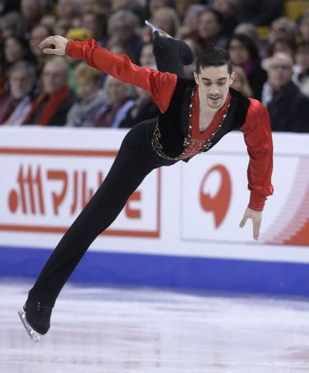 Javier Fernandez, of Spain, leaps during the men's short program in the World Figure Skating Championships Wednesday, March 30, 2016, in Boston. (AP Photo/Steven Senne)
