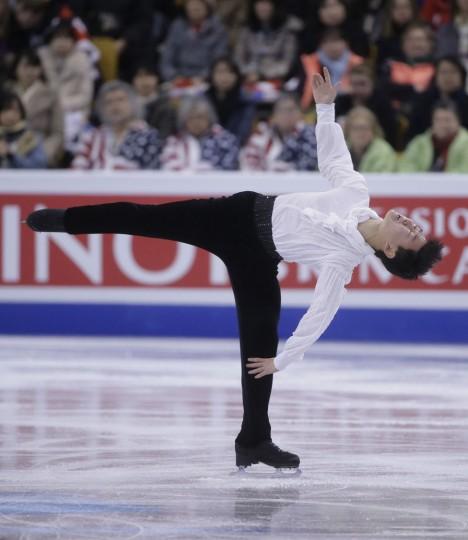 Denis Ten, of Kazakhstan, spins during the men's short program in the World Figure Skating Championships Wednesday, March 30, 2016, in Boston. (AP Photo/Steven Senne)