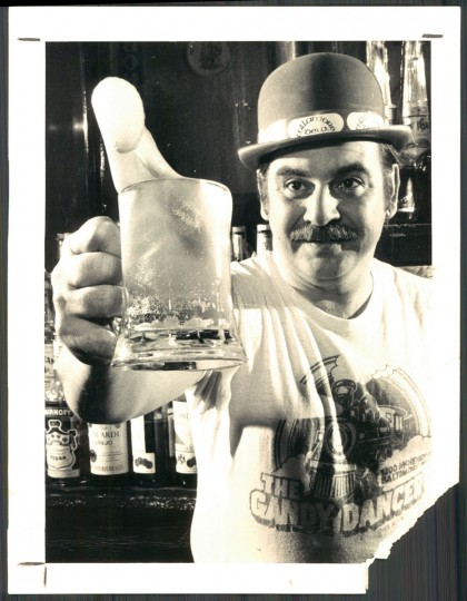 """Erin go slosh! With green suds flying, Noel Bautro toasts the advent of St. Patrick's Day among fellow Irish-at-least-for-a-week at the Gandy Dancer in the 1300 block McHenry Street."" March 1979 (Swagger, The Baltimore Sun)."