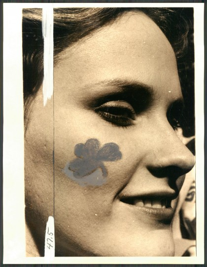 """Debbie Cook with a shamrock on her cheek at Hopkins Plaza."" 1979. (Walter M. McCardell, The Baltimore Sun)."