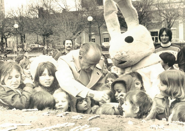 Mayor Schaefer and the Easter Bunny help youngsters to a slide of a 650-pound Easter eggs during the Mayor's Easter Party in War Memorial Plaza. (Joseph A. DiPaola/Baltimore Sun, 1977)