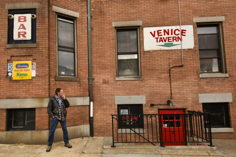 "Bob Piercey of Dundalk takes a smoke outside the Venice Tavern. He said, ""When I get up to Highlandtown, this is the first place I come. I like the atmosphere. It's quiet, never any trouble."" (Amy Davis/Baltimore Sun)"