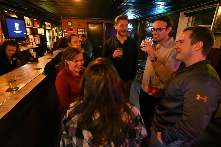 Lauren Loeffler, and Brigid McAteer chat with friends John Cornwell, Kyle Turkot, and Matias Blackhorn. The bargain craft beers are attracting a younger crowd to the Venice Tavern. (Amy Davis/Baltimore Sun)