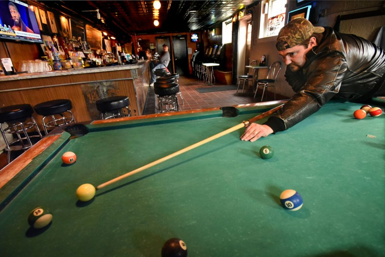 Travis Rhoades of MIddle River grew up in HIghlandtown, and stops by to have a beer and shoot pool. Pool is a dying game, unless you are in a league, he said, as he practiced by himself at the Venice Tavern. (Amy Davi/Baltimore Sun)