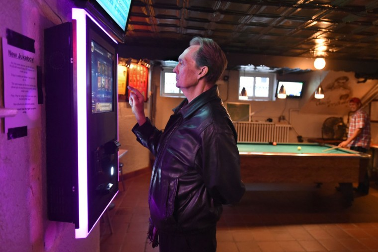 Bob Cook, a regular, makes a music selection from the digital jukebox. (Amy Davis/Baltimore Sun)