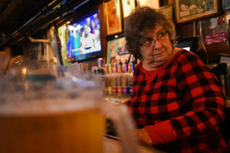 Barmaid Joanne Smith started working at the Venice Tavern in the 1970s. The Venice Tavern opens at 8 a.m., when customers mostly stop in for coffee and lottery tickets. The bar is open seven days. (Amy Davis/Baltimore Sun)