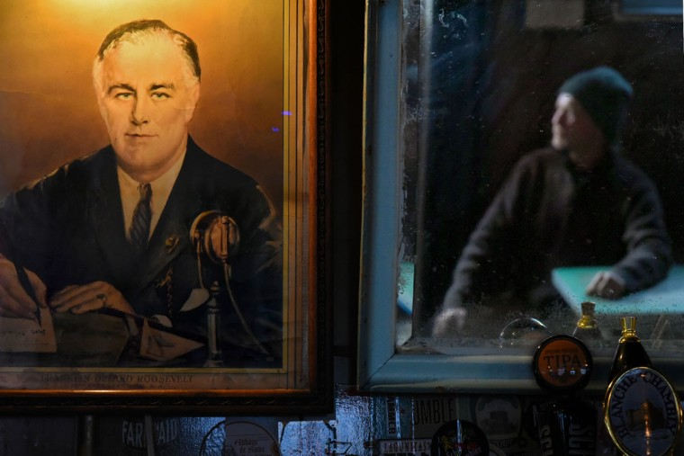 Regular customer Greg Adkins is reflected in a mirror, to the right of the portrait of Franklin Delano Roosevelt, which has hung over the bar since its beginning in 1933, when Prohibition was repealed under the FDR. (Amy Davis/Baltimore Sun)