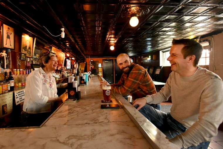 "Barmaid Mari Wick, owner Dominic DeSantis, center, and regular customer Jeremy Leposa have some laughs together. Leposa said the Venice Tavern is ""a little off the beaten path,"" but ""it's got some old school charm to it."" (Amy Davis/Baltimore Sun)"