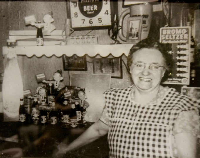 Undated photo of owner Mary Victoria DeSantis, behind the bar at The Venice Tavern in her gingham apron. She kept the tavern going after her husband died in 1962. (Courtesy of Dominic DeSantis)