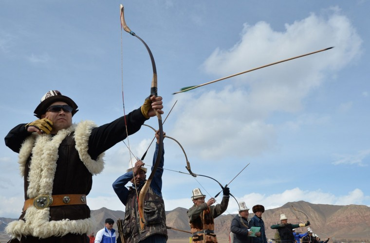 "Kyrgyz men show their archery skill during the hunting festival ""Salburun"" in the village of Alysh, near Naryn, 350 km outside Bishkek, on March 13, 2016. (VYACHESLAV OSELEDKO/AFP/Getty Images)"