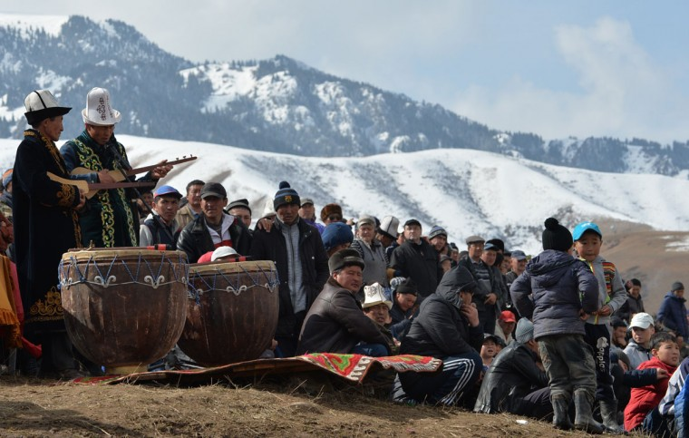 "Kyrgyz artists perform at the hunting festival ""Salburun"" in the village of Alysh, near Naryn, 350 km outside Bishkek, on March 13, 2016. (VYACHESLAV OSELEDKO/AFP/Getty Images)"