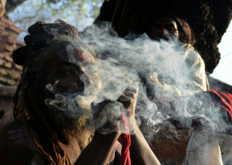 A Nepalese Sadhu (Hindu holy man) smokes marijuana using a chillum, a traditional clay pipe, as a holy offering for Lord Shiva, the Hindu god of creation and destruction, near the Pashupatinath Temple during the Maha Shivaratri festival in Kathmandu on March 7, 2016. Hindus mark the Maha Shivratri festival by offering special prayers and fasting. Hundreds of sadhu have arrived in Kathmandu's Pashupatinath to take part in the Maha Shivaratri festival. (PRAKASH MATHEMA/AFP/Getty Images)