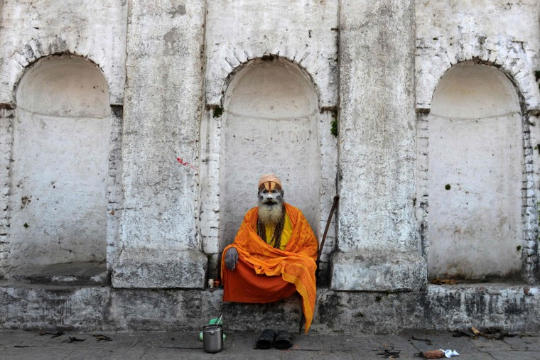A Nepalese Sadhu (Hindu holy man) looks on during preparations for the Maha Shivaratri festival in Kathmandu on March 7, 2016. Hindus mark the Maha Shivratri festival by offering special prayers and fasting. Hundreds of sadhu have arrived in Kathmandu's Pashupatinath to take part in the Maha Shivaratri festival. (PRAKASH MATHEMA/AFP/Getty Images)