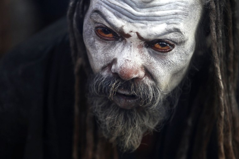 "A Hindu holy man waits to receive alms from devotees at the courtyard of the Pashupatinath temple during ""Shivaratri"" festival in Kathmandu, Nepal, Monday, March 7, 2016. ""Shivaratri,"" or the night of Shiva, is dedicated to the worship of Lord Shiva, the Hindu god of death and destruction. (AP Photo/Niranjan Shrestha)"