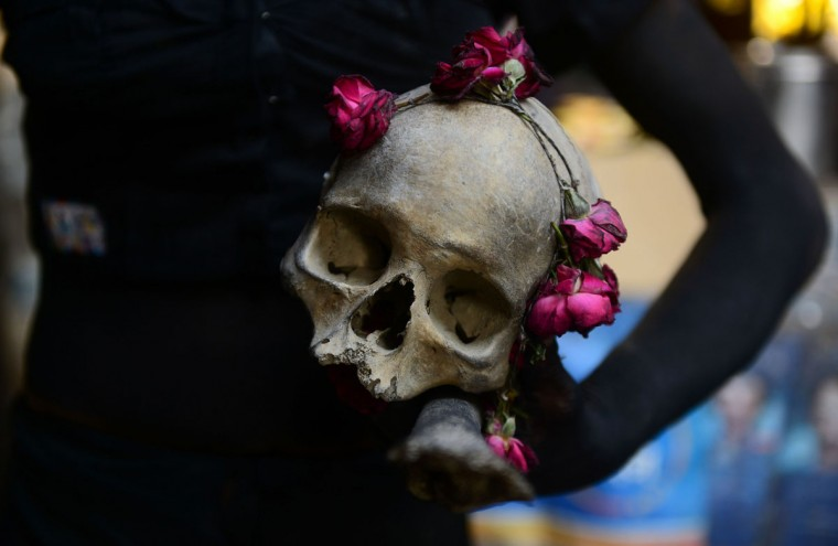 An Indian Hindu devotee of the deity Shiva holds a human skull during a religious procession to mark the Hindu festival of Maha Shivratri in Allahabad on March 7, 2016. Hindus mark the Maha Shivaratri festival by offering special prayers and fasting to worship the deity Shiva. (SANJAY KANOJIA/AFP/Getty Images)
