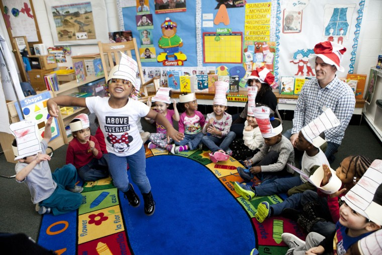 Khloe Garvin, 3, dances after making Dr. Seuss hats during a program in honor of Dr. Seuss's birthday at Head Start Ellicott City in Ellicott City, MD on Wednesday, March 2, 2016.