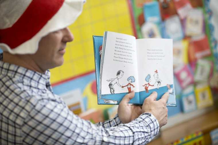 Matt Hemelt of Ellicott reads to children during a program in honor of Dr. Seuss's birthday at Head Start Ellicott City in Ellicott City, MD on Wednesday, March 2, 2016.