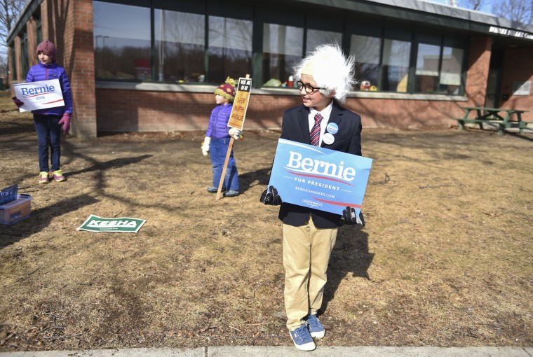 Bernie Sanders fan Angus O'Neil-Dunne, 9, stands outside with a poster as voters head inside to vote on Super Tuesday at the Robert Miller Community and Recreation Center on March 1, 2016 in Burlington, Ver. (Washington Post photo by Ricky Carioti)