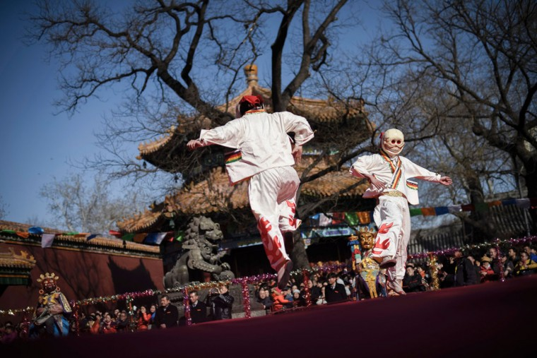 Tibetan monks dressed as demons attend the Beating Ghost festival at the Yonghe Temple, also known as the Lama Temple, in Beijing on March 8, 2016. The Beating Ghost festival, or Da Gui festival in Chinese, is an important ritual of Tibetan Buddhism and is believed to expel evil spirits and shake off troubles. (FRED DUFOUR/AFP/Getty Images)