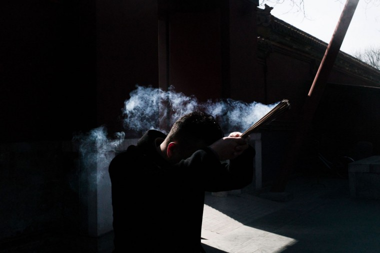 A man holds incense sticks during the Beating Ghost festival at the Yonghe Temple, also known as the Lama Temple, in Beijing on March 8, 2016. The Beating Ghost festival, or Da Gui festival in Chinese, is an important ritual of Tibetan Buddhism and is believed to expel evil spirits and shake off troubles. (FRED DUFOUR/AFP/Getty Images)