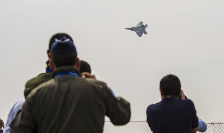Spectators watch a US F22 Raptor aircraft circling above during the XIX Air and Space Fair (FIDAE) in Santiago on March 28, 2016. (MARTIN BERNETTI/AFP/Getty Images)