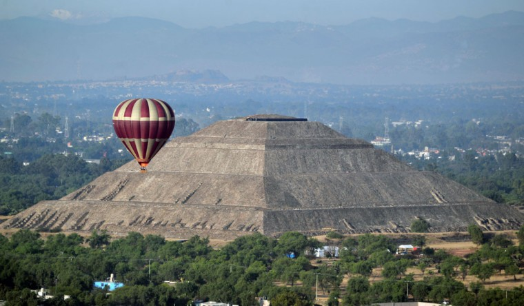 A hot air balloon overlies the Sun Pyramid at the Teotihuacan archaeological site during the Balloon Festival in San Juan de Teotihuacan, State of Mexico, on March 19, 2016. The festival is being held on the spring equinox. (Bernardo Montoya/AFP/Getty Images)