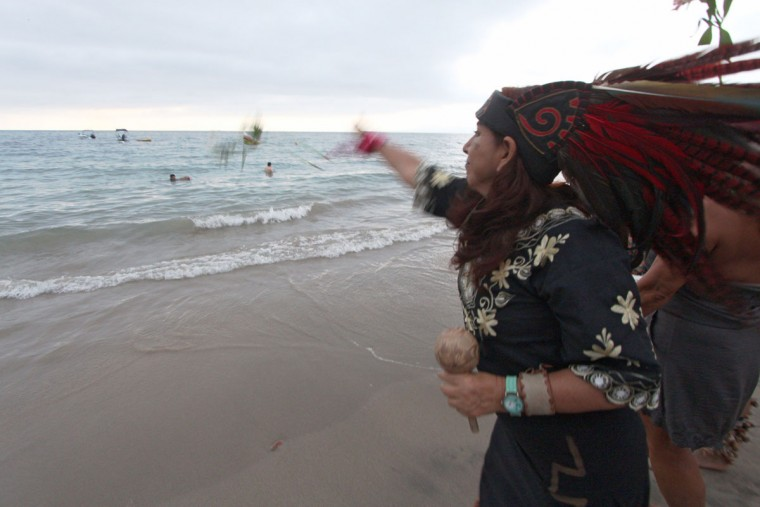 Traditional Mexican dancers throw flowers into the sea during a pre-Hispanic ritual dance and offerings to celebrate the spring equinox in Puerto Vallarta, Jalisco state, Mexico on March 21, 2016. (HECTOR GUERRERO/AFP/Getty Images)