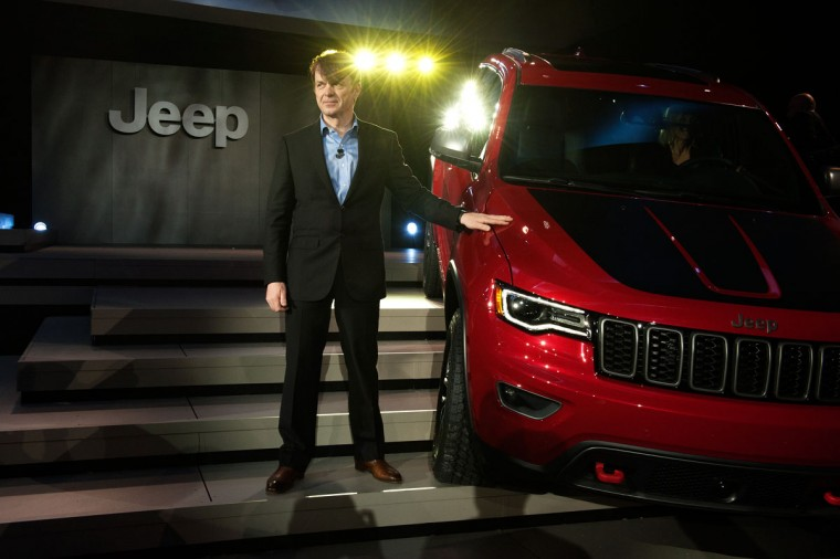 Head of Jeep Brand Mike Manley stands next to the Trailhawk model of the Jeep Grand Cherokee at the New York International Auto Show at the Javits Center on March 23, 2016 in New York City. Manley introduced the Trailhawk, a model built for off-road use, and the Summit, a model built for luxury. (Photo by Bryan Thomas/Getty Images)