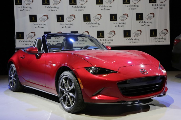 The 2016 Mazda MX-5 Miata wins the Overall World Car of the Year Award, Thursday, March 24, 2016, at the New York International Auto Show. (AP Photo/Mark Lennihan)