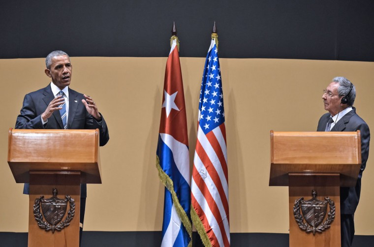 """US President Barack Obama and Cuban President Raul Castro give a joint press conference at the Revolution Palace in Havana on March 21, 2016. Cuba's Communist President Raul Castro on Monday stood next to Barack Obama and hailed his opposition to a long-standing economic """"blockade,"""" but said it would need to end before ties are fully normalized. (NICHOLAS KAMM/AFP/Getty Images)"""