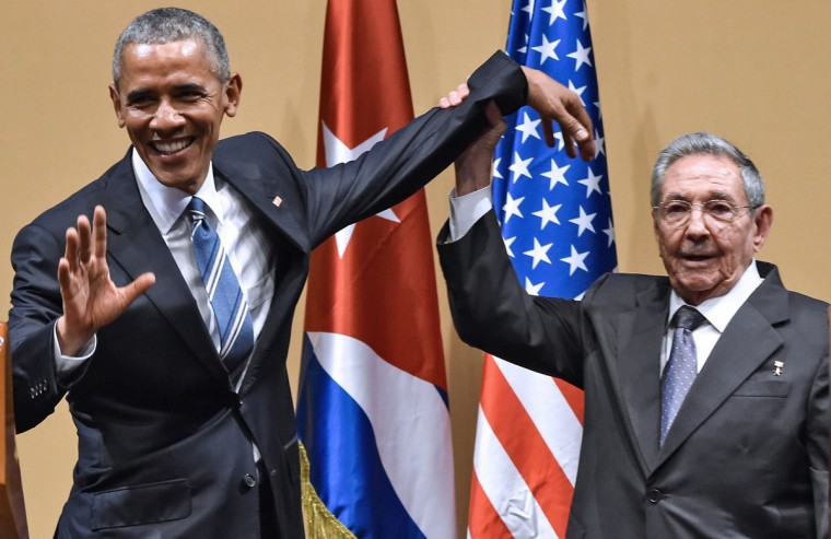 "Cuban President Raul Castro (right) raises US President Barack Obama's hand during a meeting at the Revolution Palace in Havana on March 21, 2016. Cuba's Communist President Raul Castro on Monday stood next to Barack Obama and hailed his opposition to a long-standing economic ""blockade,"" but said it would need to end before ties are fully normalized. (NICHOLAS KAMM/AFP/Getty Images)"