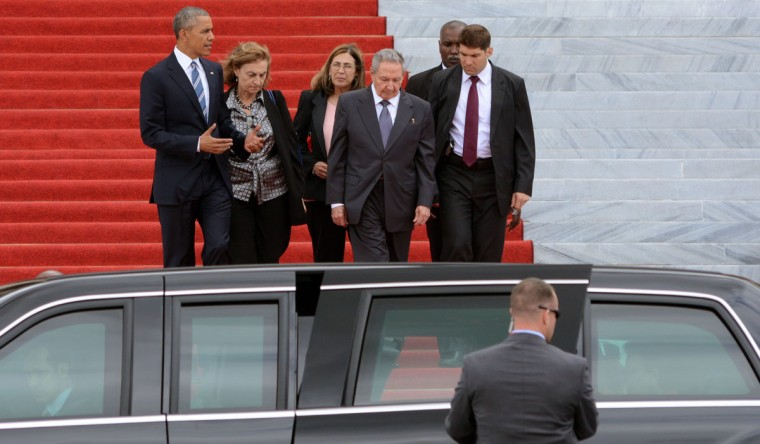 "US President Barack Obama and Cuban President Raul Castro (second from right) leave after a meeting at the Revolution Palace in Havana on March 21, 2016. On Monday, Castro stood next to Obama and hailed his opposition to a long-standing economic ""blockade,"" but said it would need to end before ties are fully normalized. (AFP/Getty Images)"
