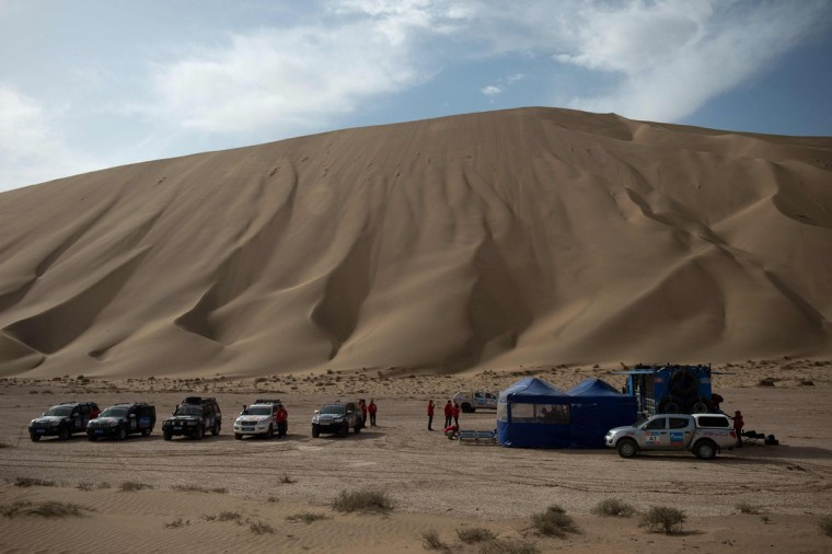 Vehicles are parked by a temporary camp during an off-road mapping recognition exercise ahead of the Silk Way Rally 2016 in the Gobi Desert. (NICOLAS ASFOURI/AFP/Getty Images)