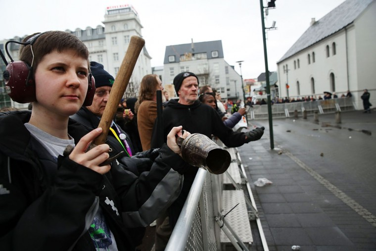REYKJAVIK, ICELAND - APRIL 06: Hundreds of protesters gather in front of the Parliament building for a third day on April 6, 2016 in Reykjavik, Iceland. Icelandic Prime Minister Sigmundur David Gunnlaugsson has stepped down after news broke on Sunday that he had hid his assets in an offshore shell-company whose existence was revealed by the Panama Papers. Numerous leaders around the world as well as wealthy individuals have been caught-up in the developing scandal. The island of just 320,000 people had only recently recovered from the global banking collapse in 2008. (Photo by Spencer Platt/Getty Images)