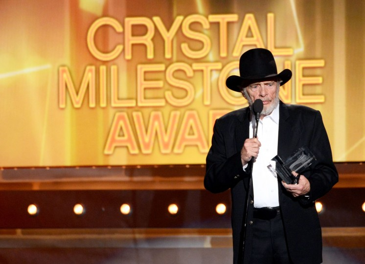 FILE - Singer/songwriter Merle Haggard accepts the ACM Crystal Milestone Award onstage during the 49th Annual Academy Of Country Music Awards at the MGM Grand Garden Arena on April 6, 2014 in Las Vegas, Nevada. (Photo by Ethan Miller/Getty Images)